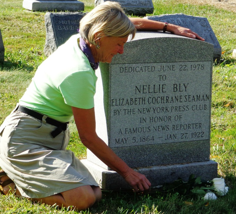 Rosemary Brown placing roses on Nellie Bly's tombstone at Woodlawn Cemetery, NYC by Alice Robbins-Fox